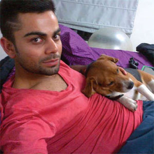 #IPL champion with his pet dog Bruno. Image - www.dogexpress.in